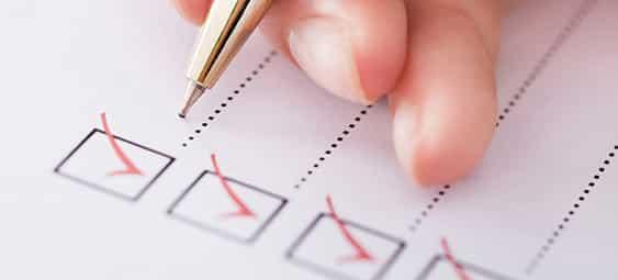 Businesswoman Writing On Checklist